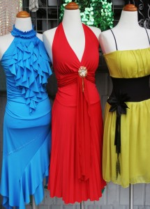 3 dresses in window sign